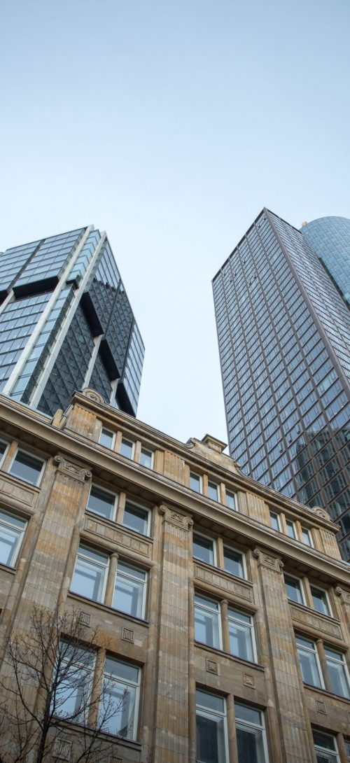 A low angle shot of high rise skyscrapers under the clear sky in Frankfurt, Germany
